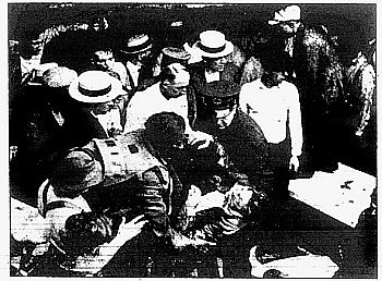 Garrett Morgan rescuing a person using his safety hood