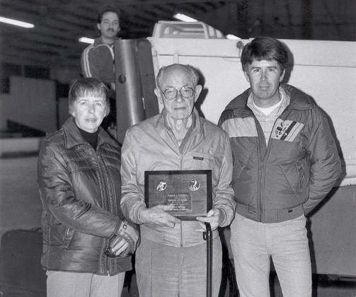 Frank Zamboni, inventor of ice resurfacing machine, with others